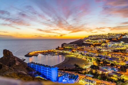 Landscape with Puerto Rico village at twilight time, Gran Canaria island, Spain