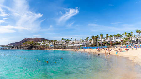 Lanzarote, Spain - October 8, 2019: Landscape with turquoise ocean water on Flamingo beach, Lanzarote, Canary Islands, Spain
