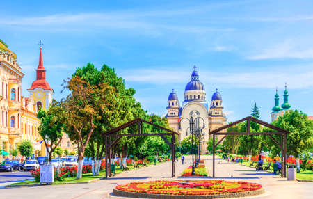 Center of Targu Mures city with ortodox church in the Roses Square, Transylvania, Romania.