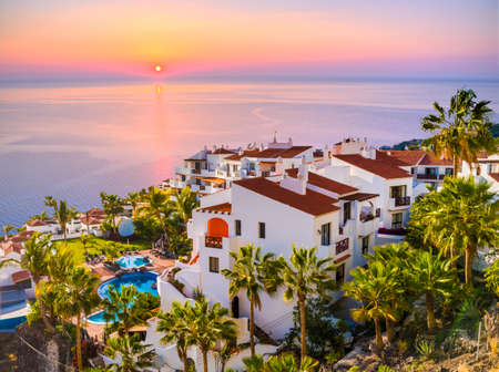 Sunrise in Puerto de Santiago city,  Atlantic Ocean coast, Tenerife, Canary island, Spain Redactioneel