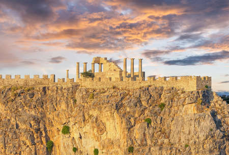 Ruins of ancient acropolis temple at sunset in Lindos, Rhodes