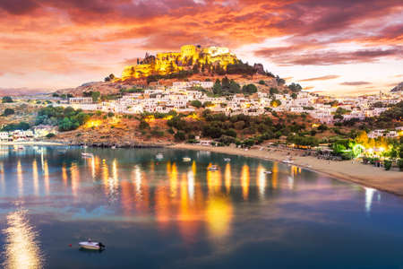 Landscape with beach and castle at twilight time in Lindos village of  Rhodes, Greece