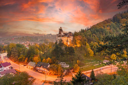 Landscape with medieval Bran castle at sunset