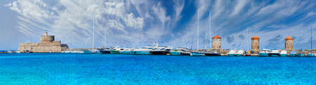 Landscape with Mandraki Harbour in Rhodes Island, Greece Banco de Imagens