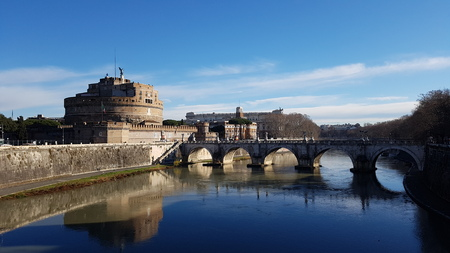 Castel Sant`Angelo is reflection, water and tourism. That marvel has river, bridge and waterway and that beauty contains landmark, château and moat.
