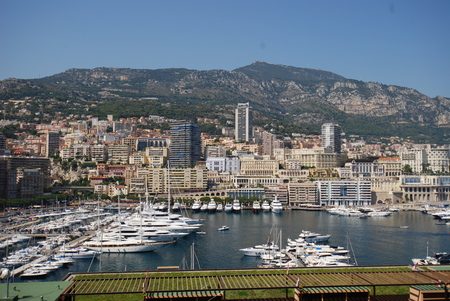 Port de Fontvieille, Monte-Carlo is aerial photography, cityscape and bird`s eye view. That marvel has town, urban area and skyline and that beauty contains city, human settlement and river.
