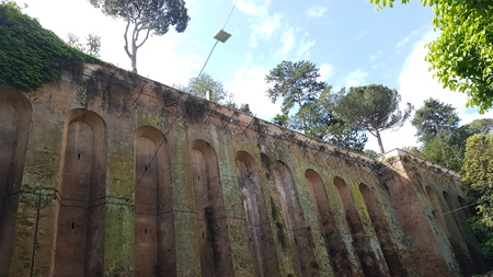 Wall is ruins, archaeological site and hacienda. That marvel has historic site, ancient history and grass and that beauty contains tree, sky and history.