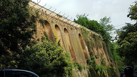 Tree is viaduct, aqueduct and dam, dike, dyke. That marvel has bridge, road and steel arch bridge and that beauty contains sky, plant and monastery. Stock Photo