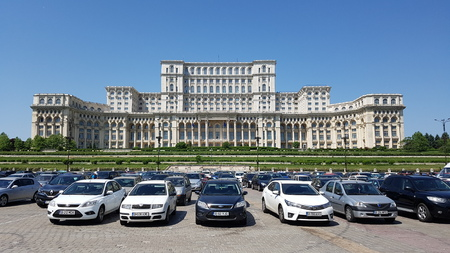 Palace of the Parliament, Romania is car, building and luxury vehicle. That marvel has land vehicle, mid size car and transport and that beauty contains landmark, family car and vehicle.