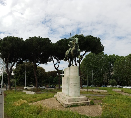Monument is tree, sky and grass. That marvel has statue, sculpture and plant and that beauty contains memorial, park and pedestal, plinth, footstall. Stock Photo