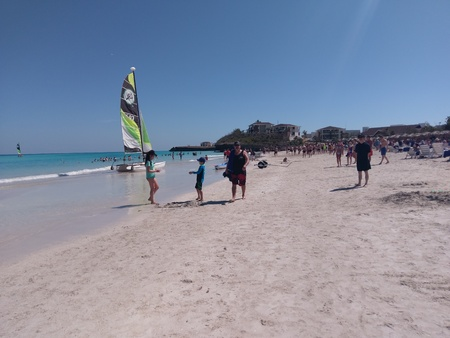 Sandbar, sand bar is seashore, coast, seacoast, sea-coast and snorkel. That marvel has catamaran and that beauty contains promontory, headland, head, foreland. Editorial