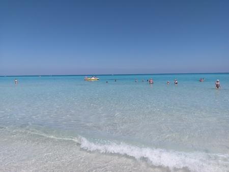 Seashore, coast, seacoast, sea-coast is sandbar, sand bar and snorkel. That marvel has sunscreen, sunblock, sun blocker and that beauty contains lakeside, lakeshore. Stock Photo