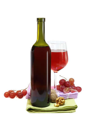 rose wine in glass, bottle and grapes