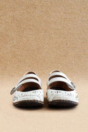 old black shoes on the background of kraft paper Stok Fotoğraf