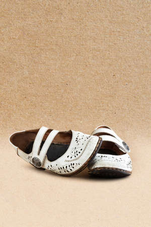 old black shoes on the background of kraft paper Stockfoto