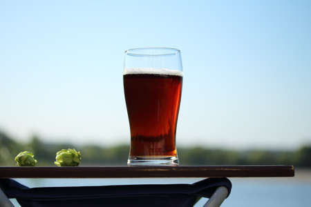 A glass of beer in nature