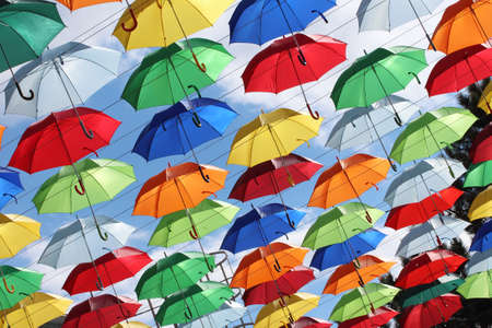Colorful umbrellas against the backdrop of the autumn sky