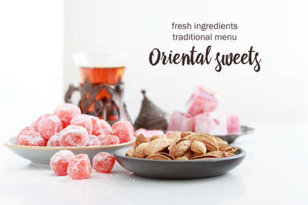 fresh Oriental sweets on the table isolated on white background