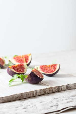 ripe figs on a chopping board Stock Photo