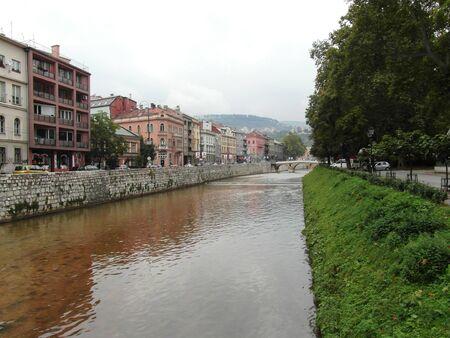 sarajevo: Narrow street in beautiful Sarajevo, river near it Stock Photo