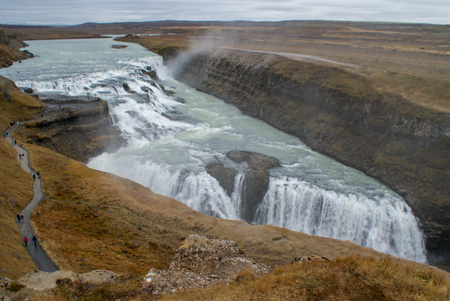 Beautiful mountains and fantastic geysers and waterfalls are popular part of Iceland and icelandic nature. Everything is close to the N1 road and accessable by usual car Foto de archivo