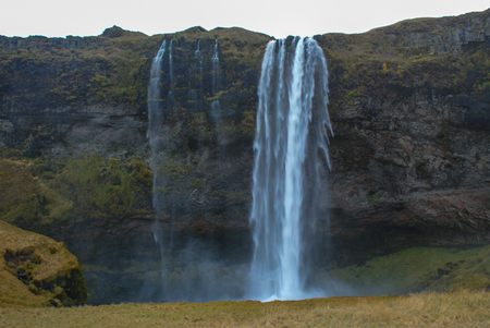 Beautiful mountains and fantastic geysers and waterfalls are popular part of Iceland and icelandic nature. Everything is close to the N1 road and accessable by usual car Foto de archivo - 120044056