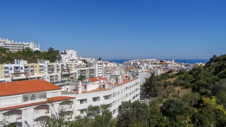 Albufeira, Algarve is a beautiful place with white houses and amazing rocks and ocean. Portugal south. It is a popular resort because of ancient white houses and beautiful rocks. 版權商用圖片