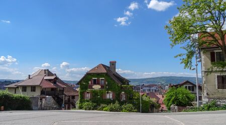 Amazing views of Annecy, beautiful ancient resort in France. Nice and good houses, blue lake and green fantastic mountains around, Alpes.