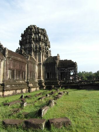 Very old and huge city Angkor Wat in Cambodia, state Siem Reap. Amazing stone buildings, a lot of green and fantastic architecture. Antic. Stok Fotoğraf