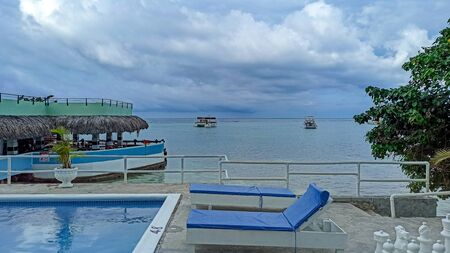 Caribbean Sea, Jamaica. Bright vegetation and life of the city of Ocho Rios. A charming resort for year-round holidays