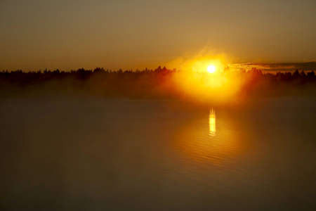 Lake and forest at the sunset fog photo