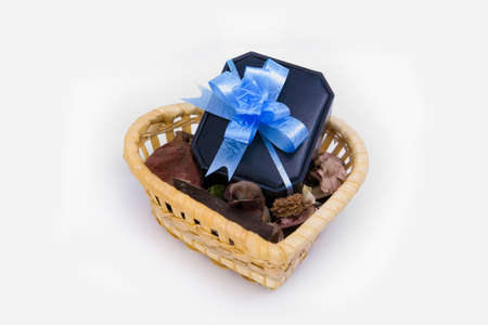 Black gift box with blue ribbon in the tray  photo