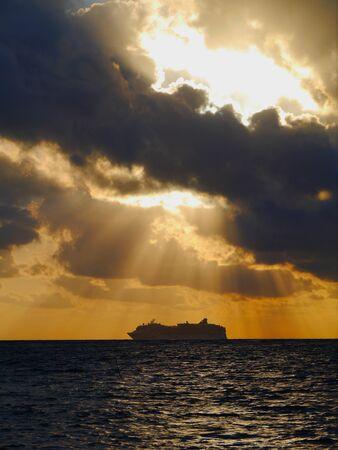 beach cruiser: sunset ocean sea beach mexico mahual and a cruiser at the horizon Stock Photo