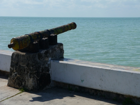 freeing: old old cannon in chetumal mexico