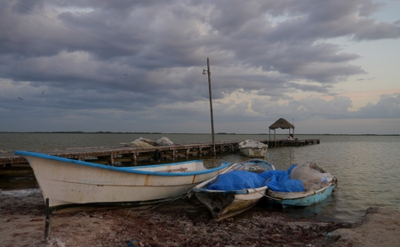 beach and ocean panorama with fisherboats  in chelem mexico  photo
