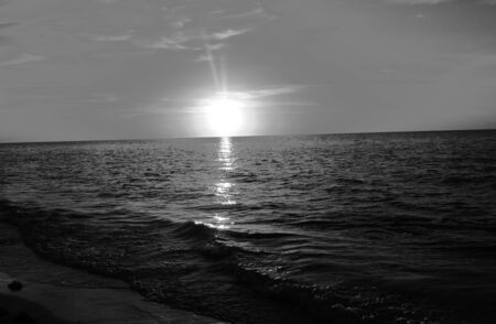 on the black sea: Black and white beach ocean pier sunset architecture