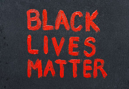 Text black lives matter on black background.