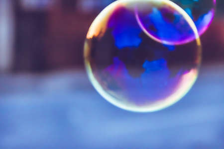 soap bubble: blue blurred natural background with soap bubble Stock Photo