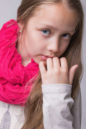 neckerchief: portrait of teenage girl fashionably dressed with pink neckerchief