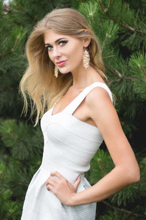 longhair: Portrait of beautiful young blond longhair woman with jewerly outdoors.
