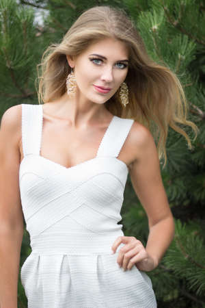 longhair: Portrait of pretty young blond longhair woman with jewerly outdoors. Stock Photo