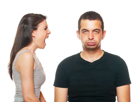 depressed person: Unhappy young couple having an argument. Isolated on white. Stock Photo