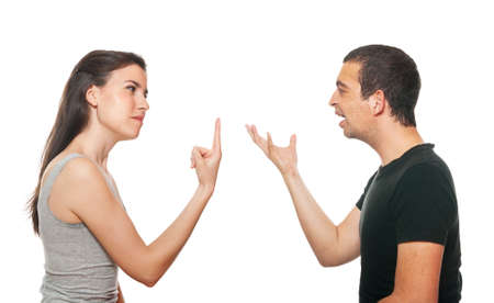 disagree: Unhappy young couple having an argument. Isolated on white. Stock Photo