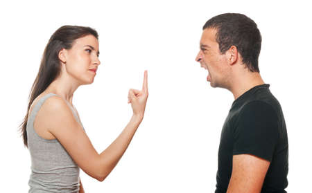 Unhappy young couple having an argument. Isolated on white. Stock Photo