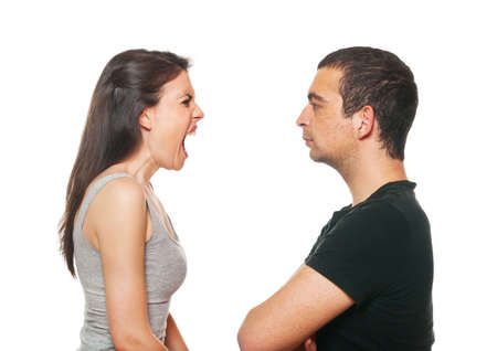 relationship problems: Unhappy young couple having an argument. Isolated on white. Stock Photo
