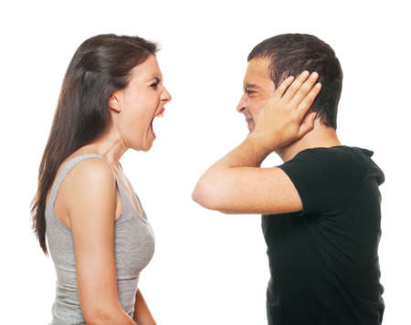 couple fight: Unhappy young couple having an argument. Isolated on white. Stock Photo
