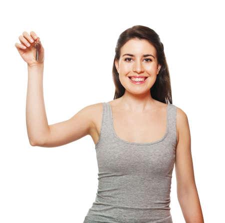 doorkey: Young female holding keys. Isolated on white