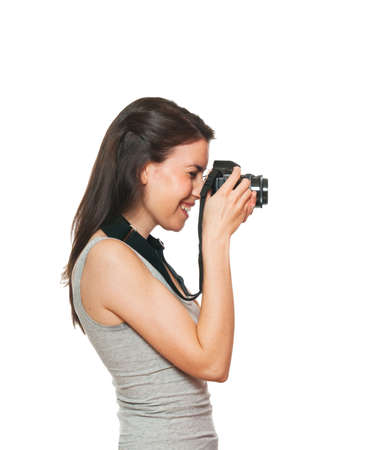 Young female taking a photo. Isolated on white photo