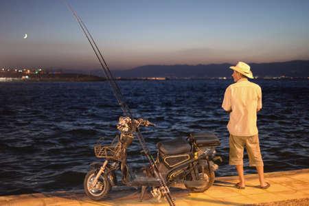 Fishing man Editorial