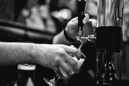 Filling beer pint horizontal Stock Photo